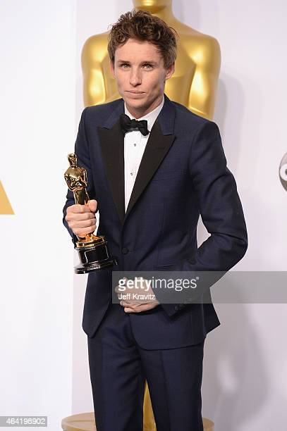 Actor Eddie Redmayne with the award for best actor for The Theory of Everything poses in the press room during the 87th Annual Academy Awards at...