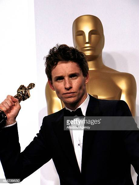 Actor Eddie Redmayne with the award for the Best Actor in a Leading Role Award for 'The Theory of Everything' poses in the press room at Loews...