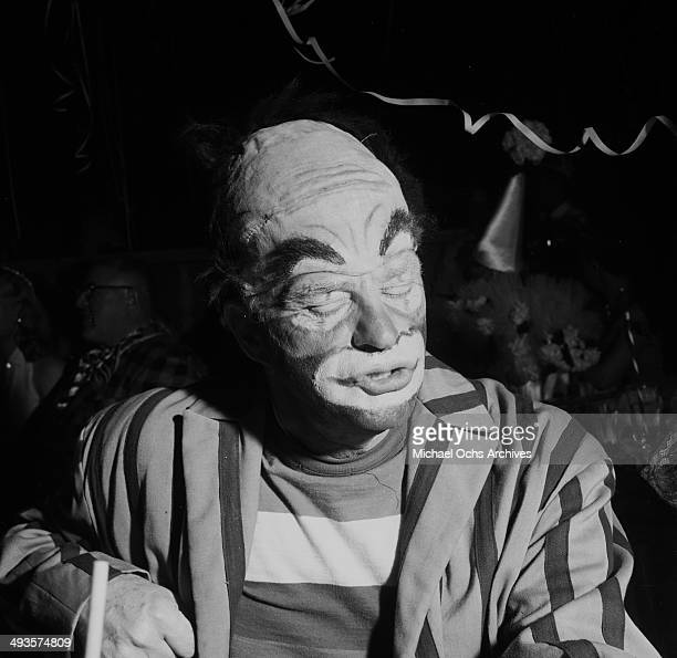 Actor Edgar Bergen dressed as a clown attends Sonja Henie's Circus Party in Los Angeles California