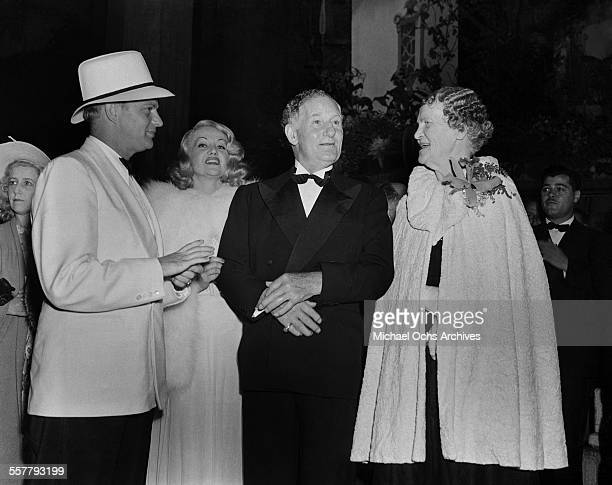 Actor Edgar Bergen with actress Paula Stone and actor Fred Stone and wife Allene Crater attend an event in Los Angeles California
