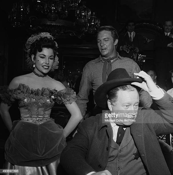 Actor Edgar Buchanan with Mara Corday and Alex Nicol attend the premiere of Red Garters in Los Angeles California