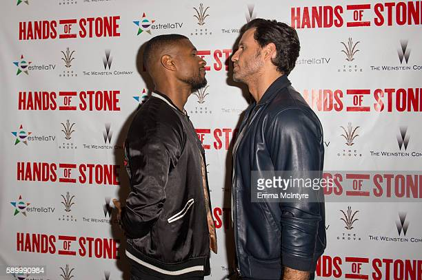 Actor Edgar Ramirez and musician Usher arrive at the screening of the Weinstein Company's 'Hands of Stone' at Pacific Theatres at The Grove on August...