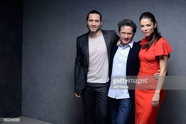 Actor Edgar Ramirez director Alberto Arvelo and actress Juana Acosta of 'Libertador' pose at the Guess Portrait Studio during 2013 Toronto...