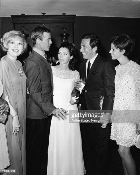 Actor Edie Adams TV host Johnny Carson and his wife Joanne singer Andy Williams and his wife Claudine Longet attend a party at a nightclub circa 1965