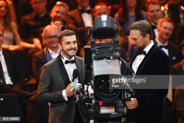 Actor Edin Hasanovic and TV host Steven Gätjen during the show of 'Goldene Kamera 2018' at Messehallen on February 22 2018 in Hamburg Germany