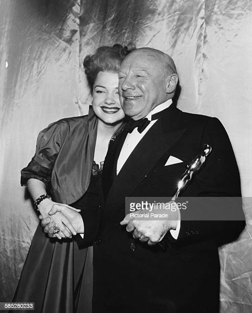 Actor Edmund Gwenn holding his Oscar for the film 'Miracle on 34th Street' with presenter Anne Baxter at the 20th Academy Awards Los Angeles March...