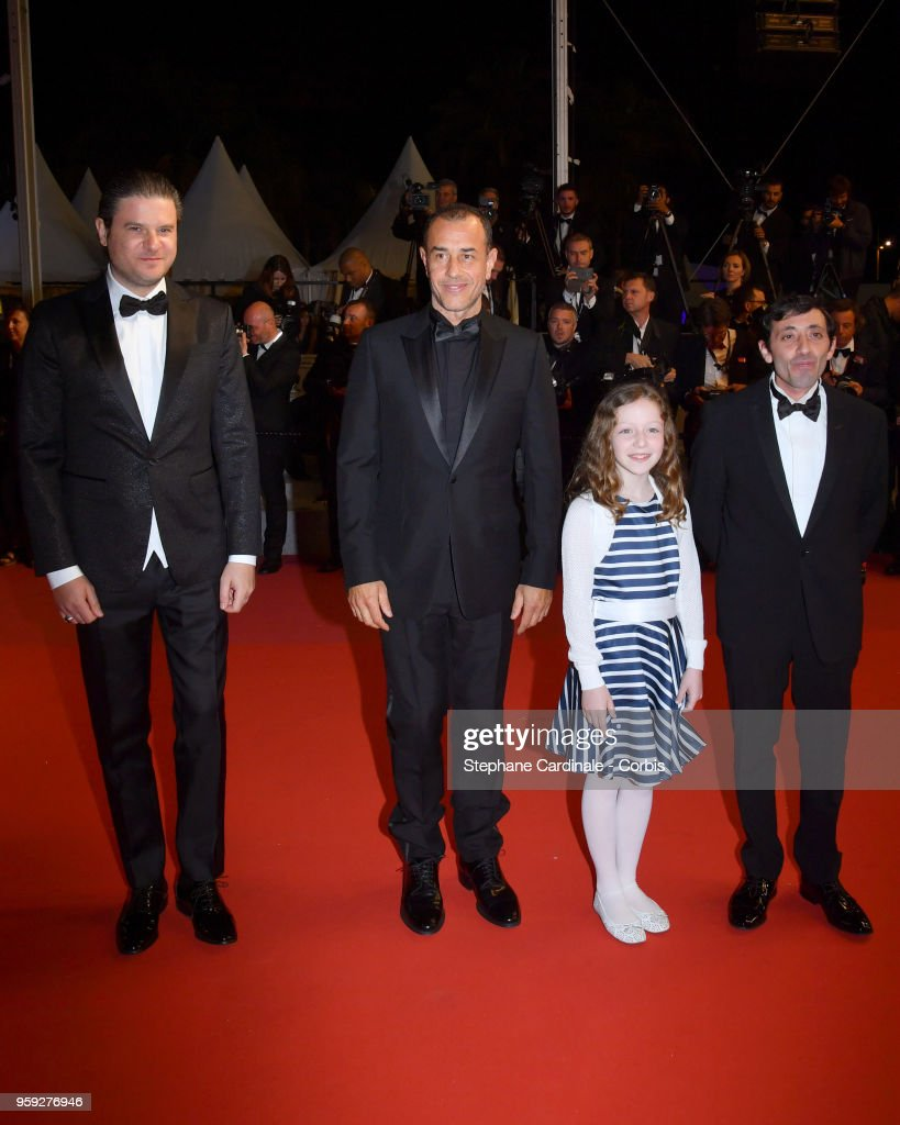 Actor Edoardo Pesce, director Matteo Garrone and actors Alida Baldari Calabria and Marcello Fonte attend the screening of 'Dogman' during the 71st annual Cannes Film Festival at Palais des Festivals on May 16, 2018 in Cannes, France.