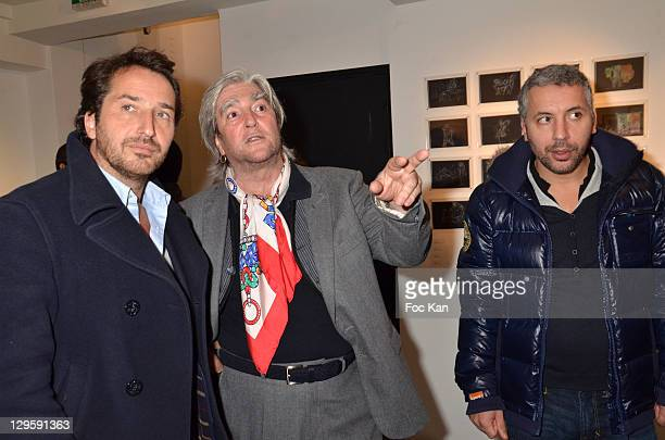 Actor Edouard Baer painter Jean Paul Chambas and actor Atmen Kelif attend the Chambas Exhibition Preview Launch at Galerie Catherine Houard on...