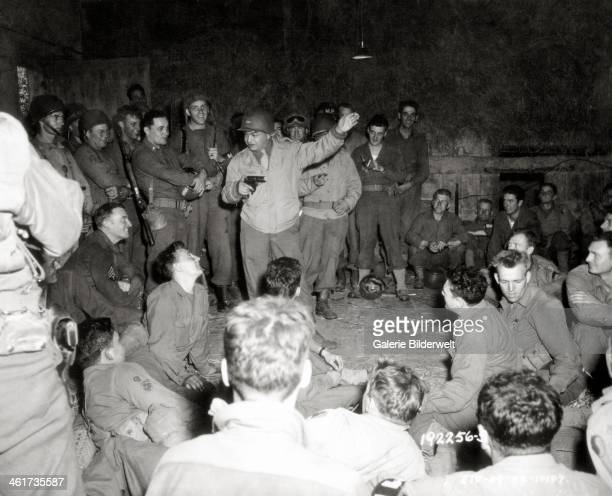 """Actor Edward G. Robinson during a tour """"Normandy World First!"""" organized by the USO. 5th – 12th August 1944. Note that the actor gave his cigar to a..."""