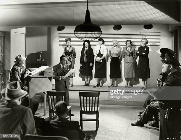 Actor Edward G Robinson in a police lineup scene from the movie 'Vice Squad' aka 'The Girl in Room 17' 1953