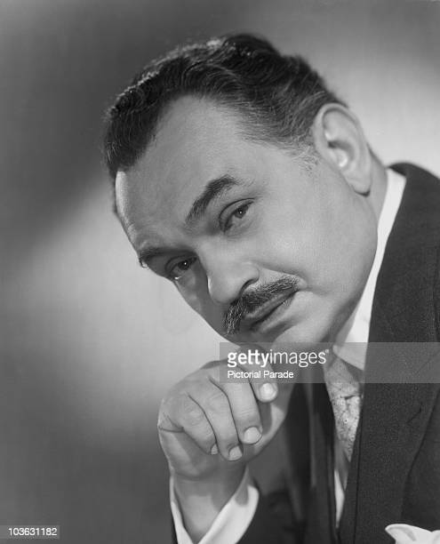 Actor Edward G Robinson pictured resting his chin on his right hand in a publicity portrait issued for the film 'Operation X' also known as 'My...
