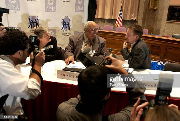 Actor Edward Norton right talks with Patricia Mail president of American Public Health Association and Georges Benjamin executive director before an...