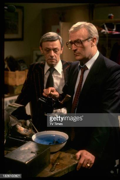 Actor Edward Woodward and Russell Hunter in the television movie Wet Job, based upon the spy drama series Callan, circa 1981.