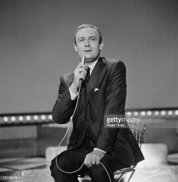 Actor Edward Woodward singing in a sketch from the BBC television series 'The Morecambe and Wise Christmas Show', 1970.