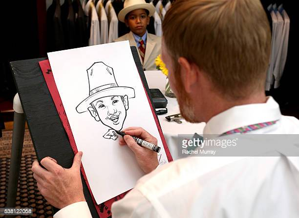 Actor Ehsan Shahidi gets his caricature drawn at Brooks Brothers Mini Classic to Benefit St Jude Children's Research Hospital at Brooks Brothers...