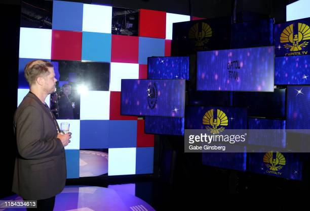 Actor Elden Henson plays an interactive trivia game during The Hunger Games: The Exhibition grand opening at MGM Grand Hotel & Casino on June 06,...