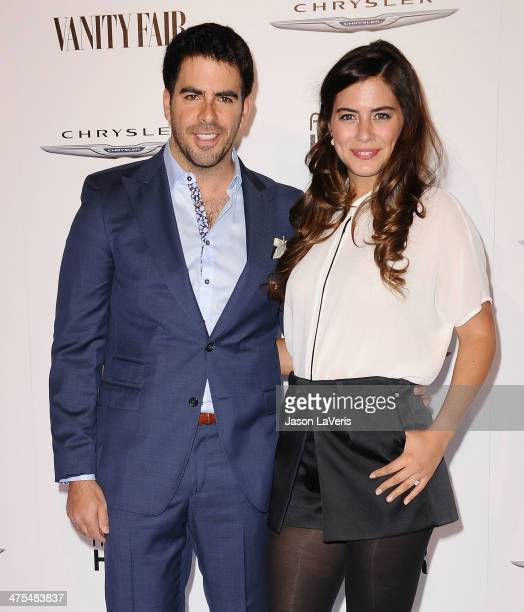 Actor Eli Roth and actress Lorenza Izzo attend the Vanity Fair Campaign Hollywood American Hustle toast at Ago Restaurant on February 27 2014 in West...