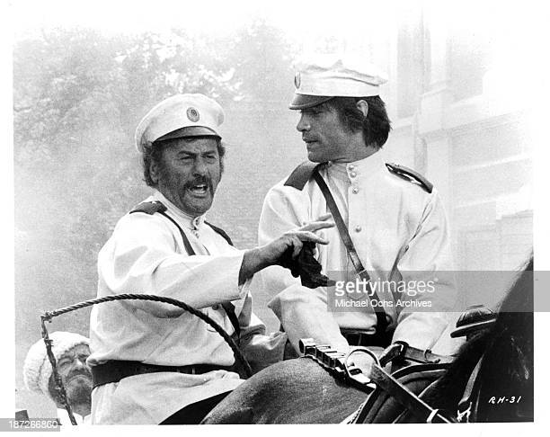 Actor Eli Wallach and actor Oliver Tobias on set of the movie Romance of a Horsethief in 1971