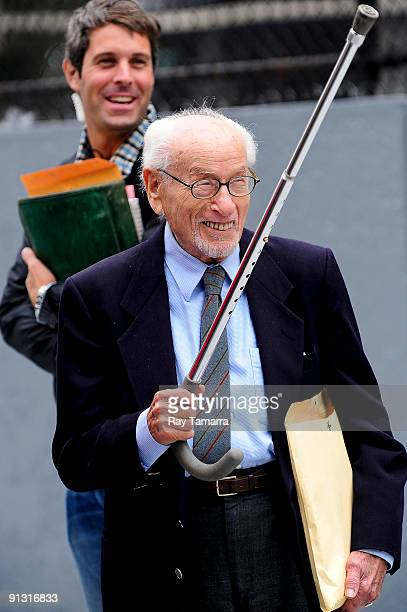 """Actor Eli Wallach walks to the """"Wall Street 2"""" movie set in midtown Manhattan on October 1, 2009 in New York City."""