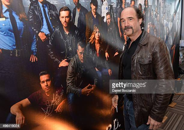 Actor Elias Koteas signs a poster as he attends a press junket for NBC's 'Chicago Fire' 'Chicago PD' and 'Chicago Med' at Cinespace Chicago Film...
