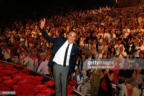 Actor Elie Semoun poses after the traditional throw of cushions at the final of 'Le placard' play at the 30th Ramatuelle Festival Day 2 on August 2...