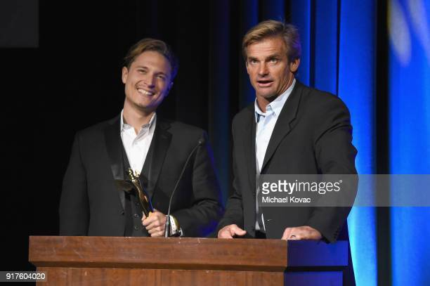 Actor Elijah AllanBlitz and professional surfer Laird Hamilton accept the 2018 Lumiere award for Best Sports VR Experience onstage at the Advanced...