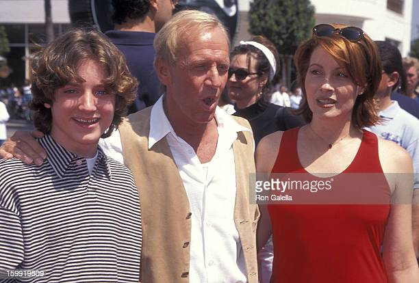 Actor Elijah Wood actor Paul Hogan and wife actress Linda Kozlowski attend the Flipper Universal City Premiere on May 5 1996 at the Cineplex Odeon...