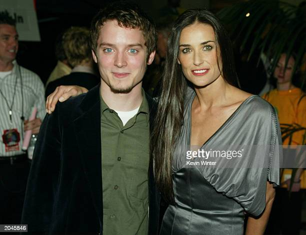 Actor Elijah Wood and actress Demi Moore backstage at The 2003 MTV Movie Awards held at the Shrine Auditorium on May 31 2003 in Los Angeles California