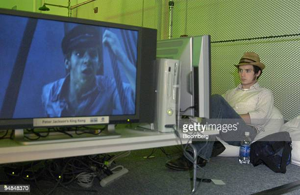 Actor Elijah Wood plays Peter Jackson's King Kong on Microsoft Corp.'s new Xbox 360 video-game console at the Zero Hour event in Palmdale, California...
