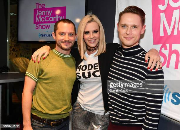 Actor Elijah Wood radio/TV personality Jenny McCarthy and actor Samuel Barnett pose for a photo at 'The Jenny McCarthy Show' at SiriusXM Studios on...