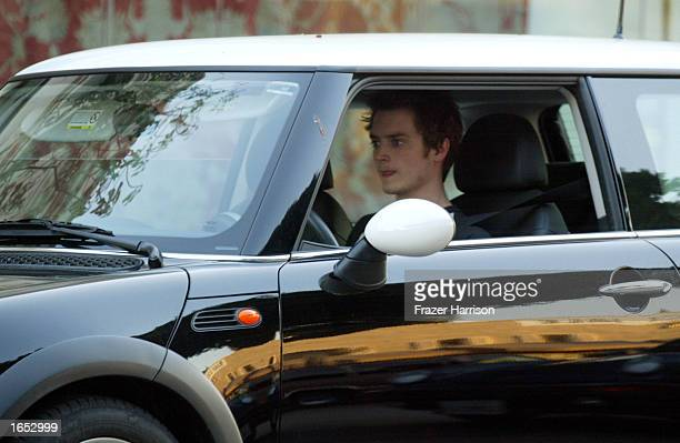 Actor Elijah Wood returns to his Mini Cooper after visiting the Urth cafe November 20 2002 in Beverly Hills California