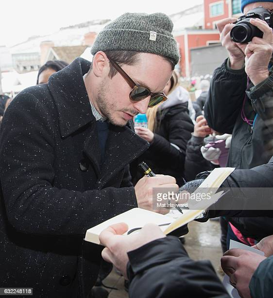 Actor Elijah Wood signs autographs during the Sundance Film Festival on January 20 2017 in Park City Utah