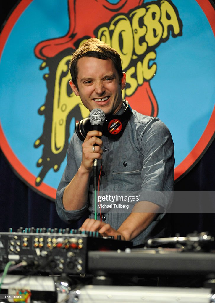 Actor Elijah Wood (a.k.a. DJ Jamie Starr) spins during a performance of Heloise & The Savoir Faire at Amoeba Music on July 10, 2013 in Hollywood, California.