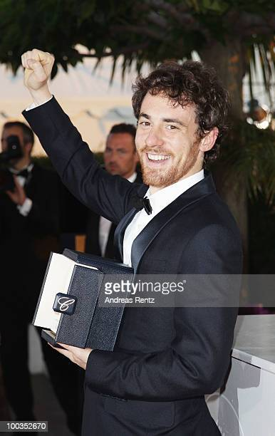 Actor Elio Germano poses with his Best Actor award for his role in 'Our Life' during the Palme d'Or Award Ceremony photocall held at the Palais des...
