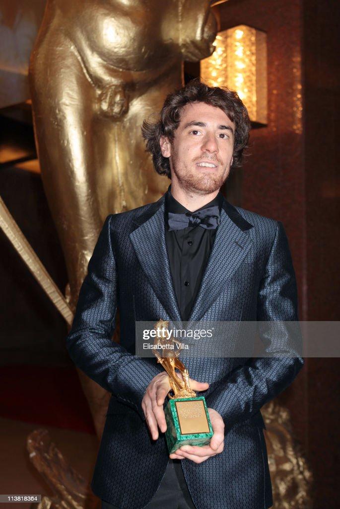 Actor Elio Germano shows his award for the Best Actor at the end of 2011 Premi David di Donatello Italian Academy Awards at Auditorium della Conciliazione on May 6, 2011 in Rome, Italy.