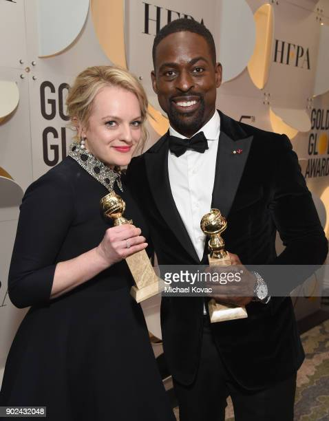 Actor Elisabeth Moss and Sterling K Brown celebrate The 75th Annual Golden Globe Awards with Moet Chandon at The Beverly Hilton Hotel on January 7...