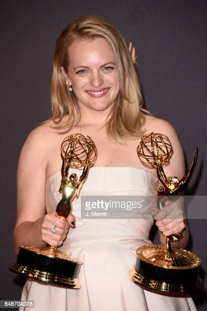 Actor Elisabeth Moss, winner of Outstanding Drama Series and Outstanding Lead Actress in a Drama Series for 'The Handmaid's Tale', poses in the press...