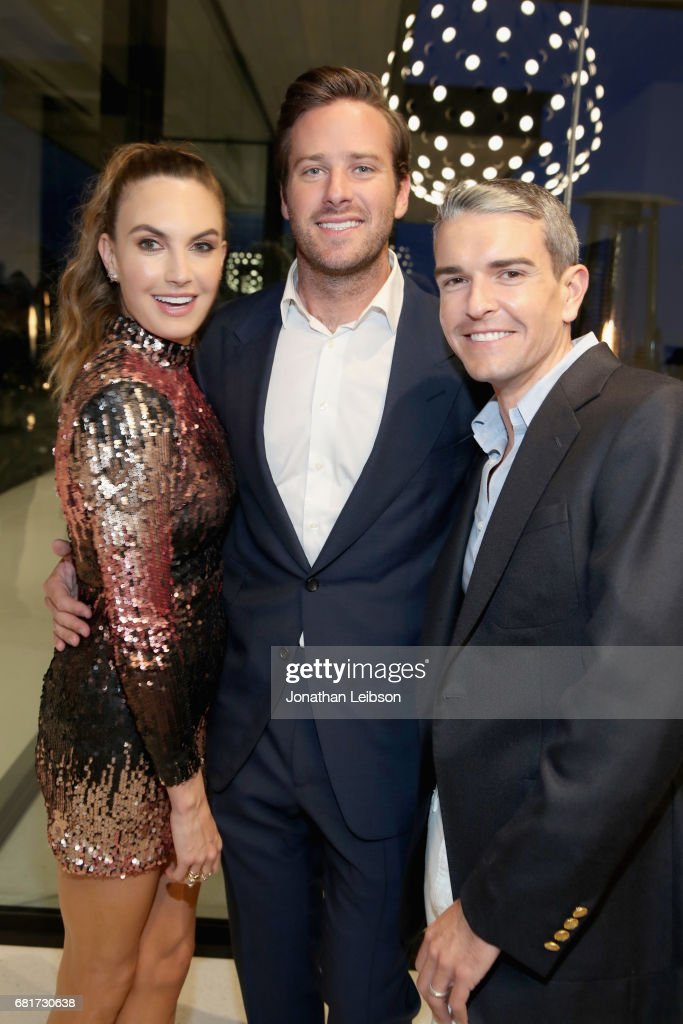 Actor Elizabeth Chambers, host Armie Hammer and photographer Gray Malin attend the private Hennessy X.O on Ice dinner, in Beverly Hills, CA on May 10, 2017. The dinner served to unveil Hennessy X.O's new 3-D printed ice bucket designed by architect Paul McClean. The ice bucket encourages serving Hennessy X.O, the world's original Extra Old Cognac, on ice to best enjoy the spirit's multisensory taste odyssey.