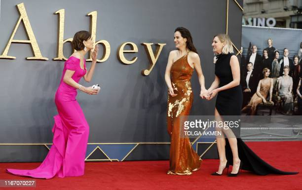 US actor Elizabeth McGovern British actor Michelle Dockery and British actor Laura Carmichael pose on the red carpet upon arrival for the world...