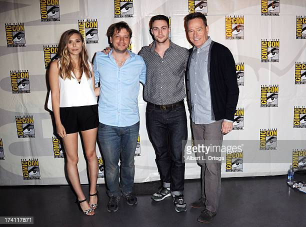 Actor Elizabeth Olsen director Gareth Edwards actors Aaron TaylorJohnson and Bryan Cranston pose backstage at the Warner Bros and Legendary Pictures...