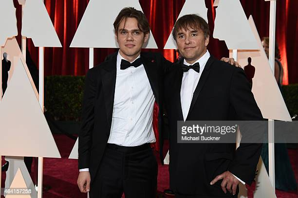 Actor Ellar Coltrane and director Richard Linklater attend the 87th Annual Academy Awards at Hollywood Highland Center on February 22 2015 in...