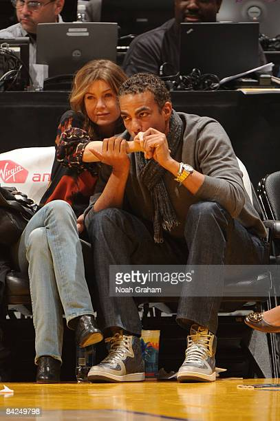 Actor Ellen Pompeo and husband Chris Ivery watch a game from courtside between the Miami Heat and the Los Angeles Lakers at Staples Center on January...