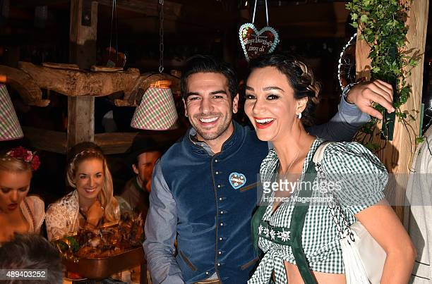 Actor Elyas M'Barek and Verona Pooth attend the Almauftrieb during the Oktoberfest 2015 at Kaefer Tent on September 20 2015 in Munich Germany