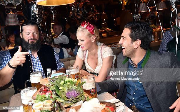 Actor Elyas M'Barek Franziska Knuppe and her husband Christian Moestl attend the Almauftrieb during the Oktoberfest 2015 at Kaefer Tent on September...