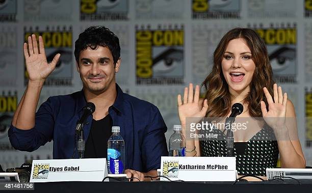 Actor Elyes Gabel and actress/singer Katharine McPhee wave as they attend CBS TV Studios' panel for 'Scorpion' during ComicCon International 2015 at...