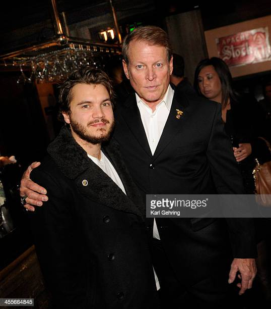 Actor Emile Hirsch left posed for a photo with Dan Dietz right at a movie screening Thursday night December 12 2013 Hirsch portrays his son Danny...