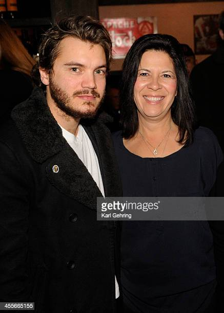 Actor Emile Hirsch left posed with Cindy DietzMarsh right at a movie screening Thursday night December 12 2013 Hirsch portrays hers son Danny in the...