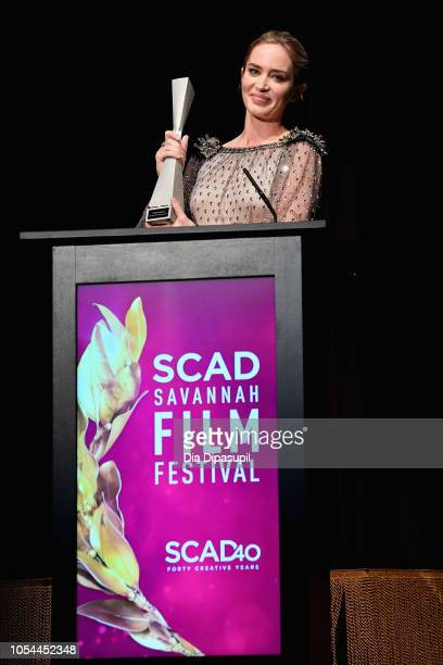 "Actor Emily Blunt accepts an award onstage during the ""A Quiet Place"" award presentation and screening at the 21st SCAD Savannah Film Festival on..."