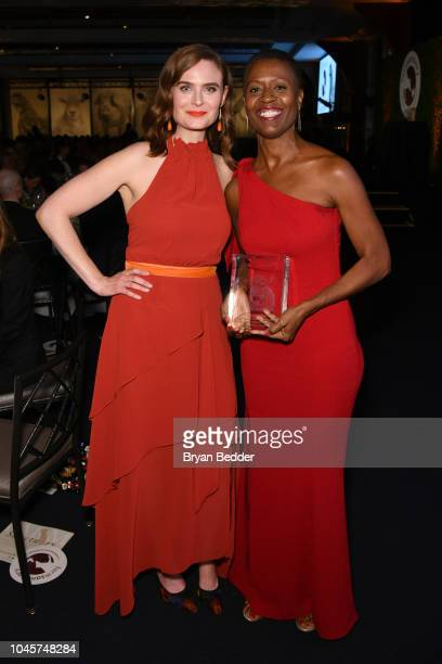 "Actor Emily Deschanel and honoree Tracye McQuirter pose as Tracye McQuirter accepts the ""Compassionate Vegan Living Award"" during the 2018 Farm..."