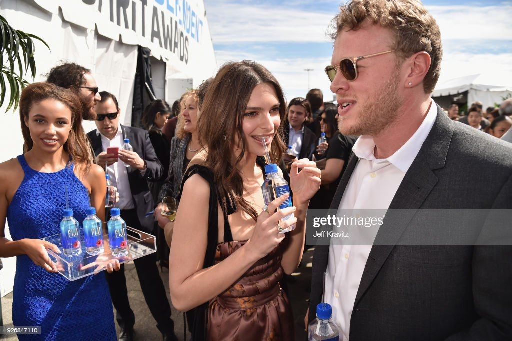 Actor Emily Ratajkowski (L) and Sebastian Bear-McClard with FIJI Water during the 33rd Annual Film Independent Spirit Awards on March 3, 2018 in Santa Monica, California.